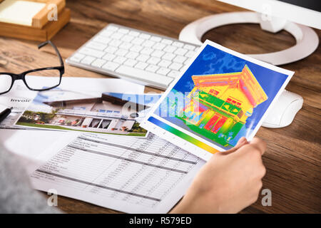 Person Analyzing The Thermal Image Of A House - Stock Photo
