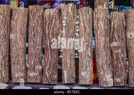 Thanaka wood for sale at rural market. Tanaka is Burmese tradition cosmetic made from bark of tanaka tree. - Stock Photo