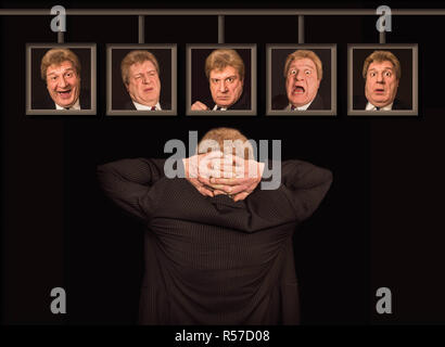 The senior european man in front of posters with his faces. - Stock Photo