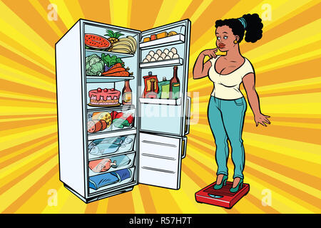 Diet. Young woman on scales, stand next to the refrigerator with - Stock Photo