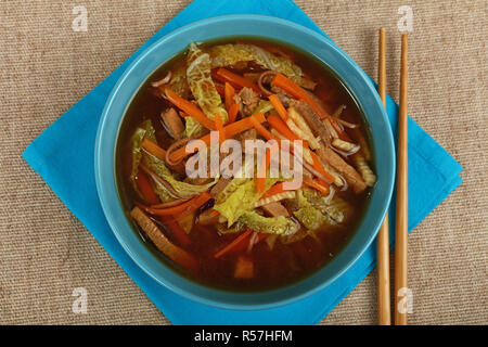 Asian noodle ramen soup with beef and vegetables - Stock Photo