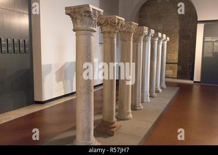 Italy, Brescia - December 24 2017: the view of Pillars representing architecture and decoration XI - XV centuries in Santa Giulia museum. - Stock Photo