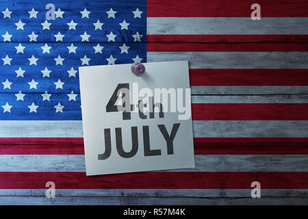 Happy Fourth 4th of July note on america flag - Stock Photo