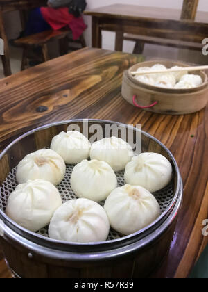 portion of chinese baozi in cheap eatery - Stock Photo