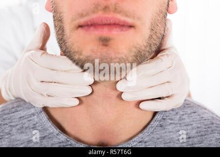 Man Getting Thyroid Gland Control - Stock Photo
