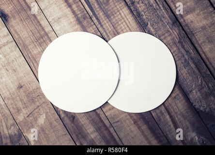 Two beer coasters - Stock Photo