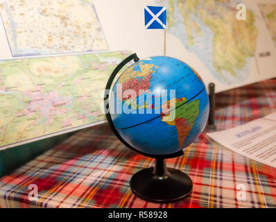 The Scotland flag is inserted in a globe and displayed with maps at the 34th annual Mobile International Festival, Nov. 17, 2018, in Mobile, Alabama. - Stock Photo