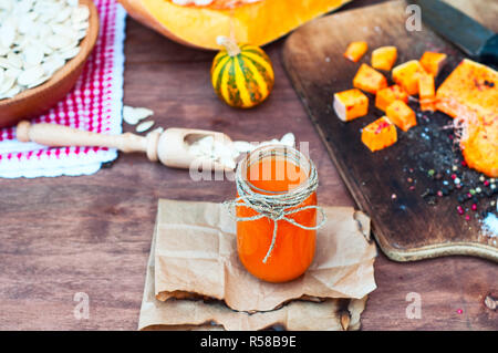 Pumpkin juice with spices in a glass jar - Stock Photo