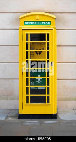 BATH, UK - NOVEMBER 29, 2018: Defribillator Telephone box in Bath - Stock Photo