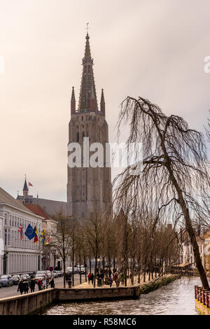 Belgium, Bruges, Brugge, a canal with church of our lady in the background - Stock Photo