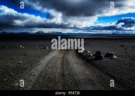 Gravel road in the wasteland in the highlands, Sprengisandsleið, Iceland - Stock Photo