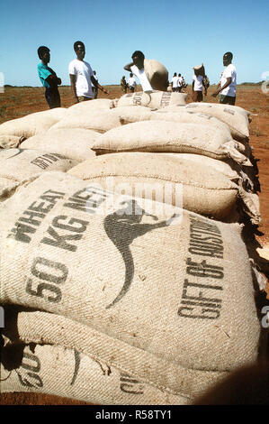 1993 - Men from the village of Maleel Somalia stack bags of wheat delivered by Marine Heavy Helicopter Squadron 363 (HMH-363) during the multinational relief effort Operation Restore Hope. Stock Photo