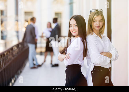Two bussiness partners women over team background - Stock Photo