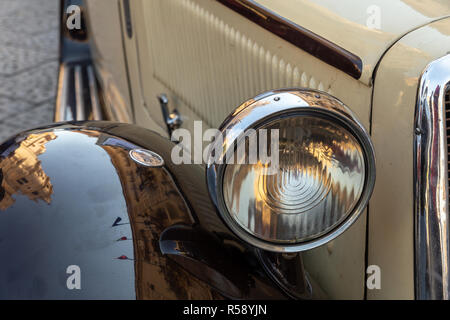 Detail of a spotlight of an old car - Stock Photo