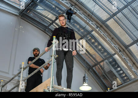 London, UK. 30th November, 2018. Greg Rutherford in his last ever Long Jump challenge British public challenged to attempt Tom Cruise's leap in Mission: Impossible - Fallout at The Lindley Hall on 30 November 2018, London, UK. Credit: Picture Capital/Alamy Live News - Stock Photo