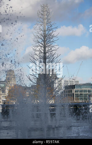 London,UK,30th November 2018,Blue skies over a Christmas Tree in front of the water fountains in Queenswalk by the River Thames in Central London, the weather forecast is for showers for the rest of the weekend.Credit Keith Larby/Alamy Live News - Stock Photo