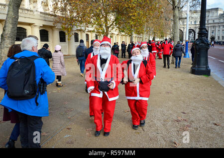 London, UK. 30th November 2018. The last day of November sees a gathering of (mostly female) Santas in the Mall Credit: - Stock Photo