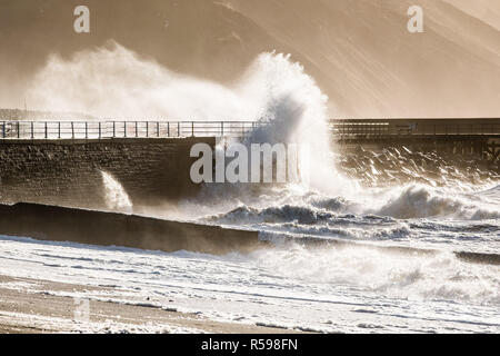 Aberystwyth Wales, UK. 30th Nov, 2018. UK Weather : In the aftermath of Storm Diana, strong gale force winds continue hammer huge waves against the sea defences in Aberystwyth on the Cardigan Bay coast of west Wales. photo Credit: keith morris/Alamy Live News - Stock Photo