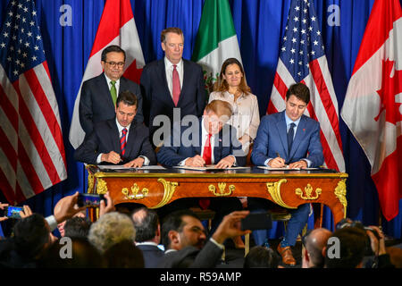 U.S. President Donald Trump, center, Canadian Prime Minister Justin Trudeau, right, and Mexican President Enrique Pena Neto, left, during a signing ceremony for the new NAFTA trade agreement called USMCA November 30, 2018 in Buenos Aires, Argentina. - Stock Photo