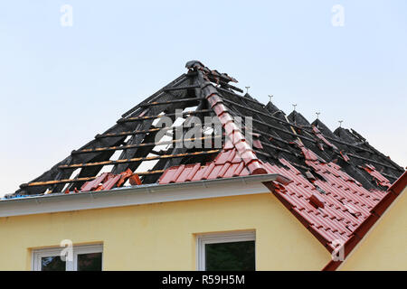 burnt rooftop after fire - Stock Photo