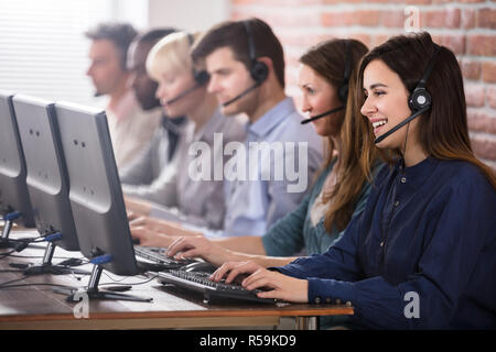 Female Customer Services Agent In Call Center - Stock Photo