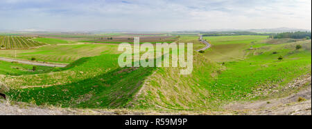 Panoramic landscape of the Jezreel Valley viewed from Megiddo. Northern Israel - Stock Photo