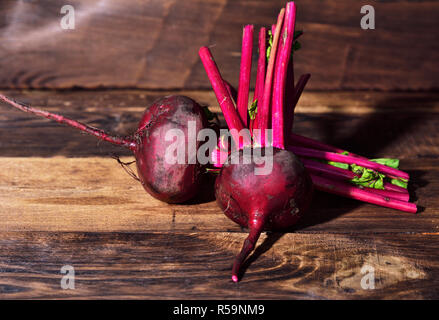 Two fresh beets on a brown wooden background - Stock Photo