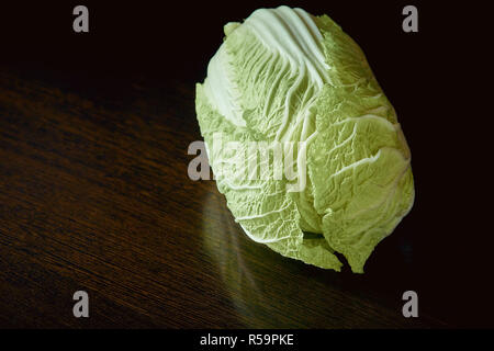 healthy vegetarian food, organic Peking cabbage on dark background - Stock Photo