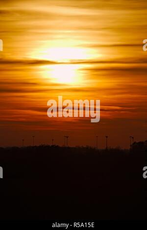 Sunset behind clouds - Stock Photo