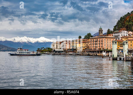 Winter view of Bellagio, Lake Como, Lombardy, Italy with the snowy Alps in the background - Stock Photo