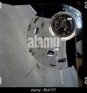 (7-19 Dec. 1972) --- In this view, taken from the Lunar Module (LM), the Command and Service Module (CSM) are seen preparing to rendezvous with the LM. Note the reflection of the lunar surface on the CSM. - Stock Photo