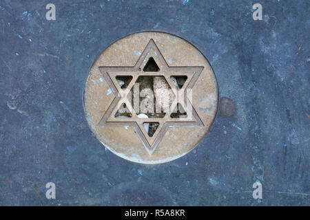 Star of David Jewish symbol at gravestone close up - Stock Photo