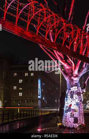 Warsaw, Poland, 25th Nov, 2018: Barbed wire and monument in front of the Museum of Pawiak Prison, the largest German prison in Warsaw during WW2. - Stock Photo