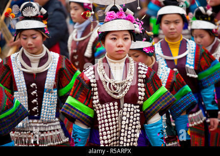 Miao girls dancing at festival nr Kaili, Guizhou Province, China - Stock Photo
