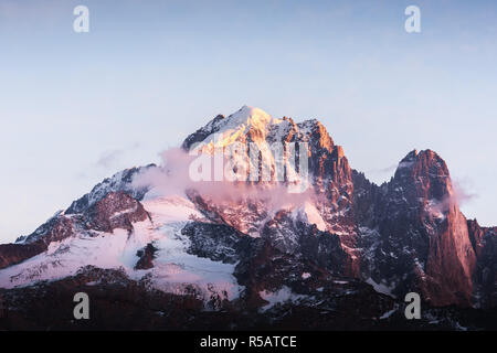 Incredible colorful sunset on Aiguille Verte peak in French Alps. Monte Bianco range, Mont Blank massif, France. Landscape photography - Stock Photo