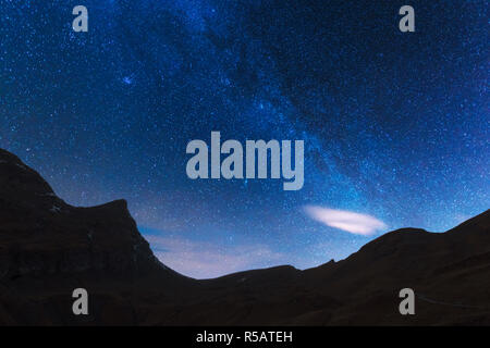 Incredible night view of Milky Way in blue sky. Swiss Alps, Switzerland. Landscape astrophotography - Stock Photo