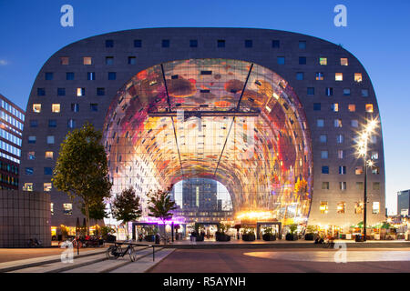 Rotterdam, Netherlands – September 26, 2018: Exterior at twilight of the famous markthal or market hall in Rotterdam - Stock Photo