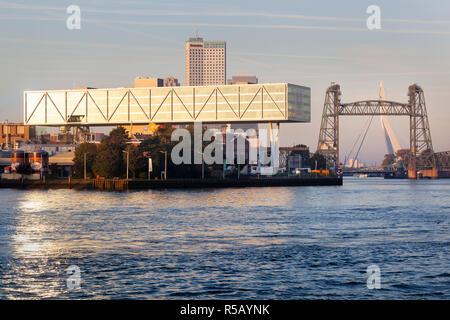 Rotterdam, Netherlands – October 5, 2018: Unilever building Rotterdam with bridge De Hef and the Erasmus bridge in the background - Stock Photo