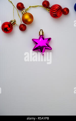 Christmas toys are on a light background. Christmas composition, winter season. - Stock Photo