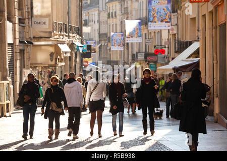 France, Languedoc-Roussillon, Herault Department, Montpellier, pedestrians on rue de la Loge - Stock Photo