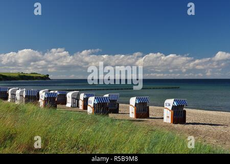 cliff,baltic sea and beach chairs on the beach of boltenhagen,orsteil redewisch,nordwestmecklenburg,northern germany - Stock Photo