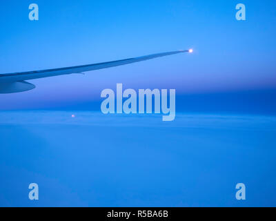 Moonrise during a flight - Stock Photo