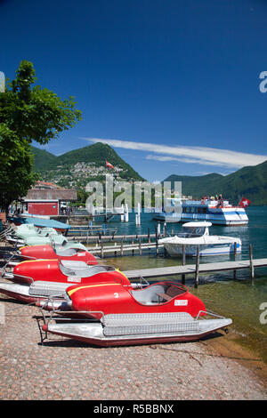 Switzerland, Ticino, Lake Lugano, Lugano, lakefront with paddleboats - Stock Photo