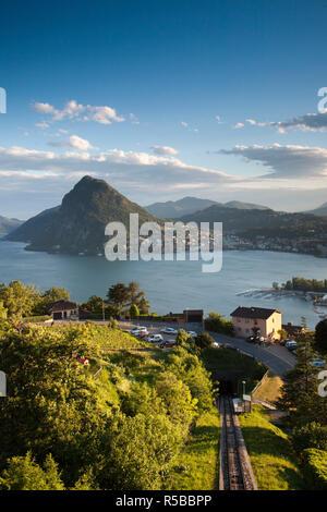 Switzerland, Ticino, Lake Lugano, Lugano, town view and Monte San Salvador from Monte Bre - Stock Photo
