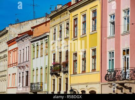 colorful facades of old buildings at the main square of beautiful town - Stock Photo