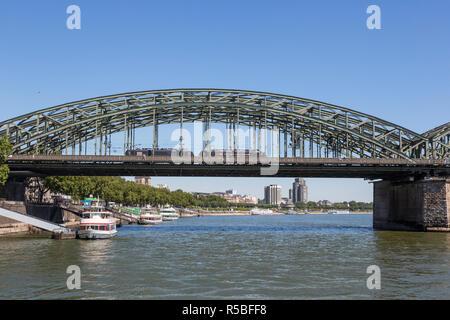 Cologne, Germany.  Hohenzollern Bridge over the Rhine, a Railway and Pedestrian Bridge, Busiest Railway Bridge in Germany. - Stock Photo
