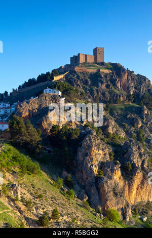 The Mudejar Castle overlooking the mountain village of Segura de la Sierra, Jaen Province, Andalusia, Spain - Stock Photo