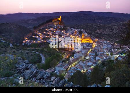 Montefrio illuminated at dusk, Granada Province, Andalusia, Spain - Stock Photo