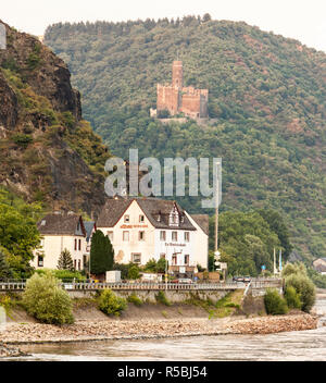 Rhine River Valley, Germany.  Maus Castle, 14th century, above Wellmich Village. - Stock Photo