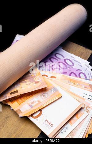 Baseball bat with money. Corruption extortion concept - Stock Photo